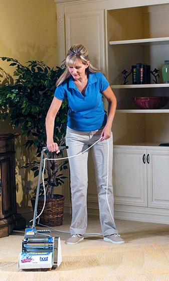 Woman using HOST Dry Carpet Cleaning System